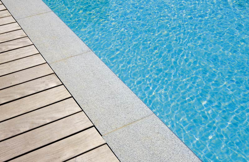 Swimming pool surrounds kent swimming pool coping stones for Swimming pool surrounds design